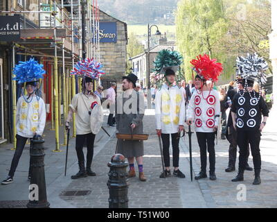 Young performers in traditional costume perform the Midgley Pace Egg Play at Hebden Bridge, a traditional mumming play in the Calder Valley - Stock Photo