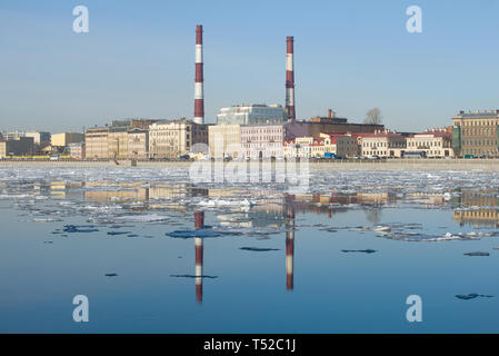 View of Sinopskaya Embankment in the sunny April afternoon. St. Petersburg, Russia - Stock Photo