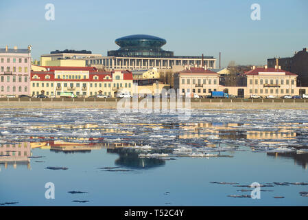 ST. PETERSBURG, RUSSIA - APRIL 12, 2018: Ice drift  on Neva against the background of Sinopskaya Embankment in the sunny April afternoon - Stock Photo