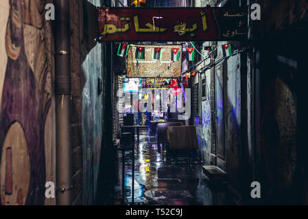 Narrow alley with shops and small restaurants in Amman city, Jordan - Stock Photo