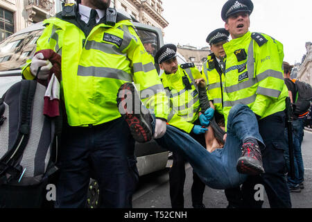 Environmental activists from Extinction Rebellion movement occupy London's Oxford Circus - Stock Photo