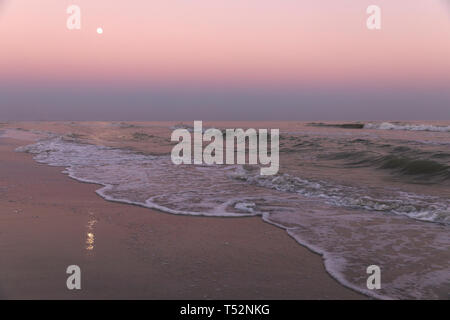 USA,Florida,Sanibel Island, a full moon rising over the surf of the Gulf of Mexico - Stock Photo