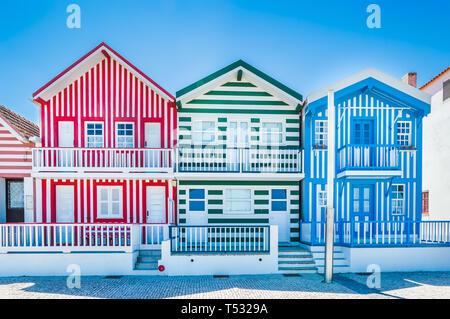 Costa Nova, Portugal: colorful striped houses called Palheiros with red, blue and green stripes. Costa Nova do Prado is a beach village resort on Atla - Stock Photo