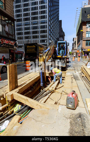 19 APRYL 2019 NY. USA Replacement of digging works road workers doing pipe renewal work on a supply line on Manhattan - Stock Photo