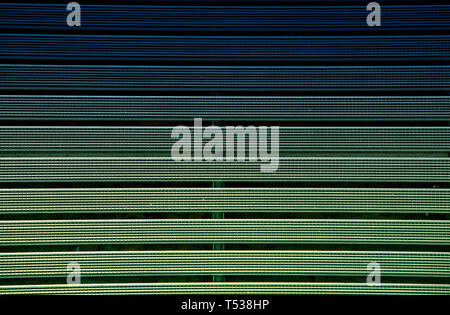 Metal grating with rubber textured green coating.Texture.Background. - Stock Photo