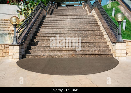 Open city stairs, under the evening sun, with escalator on the right, wide view from below. - Stock Photo