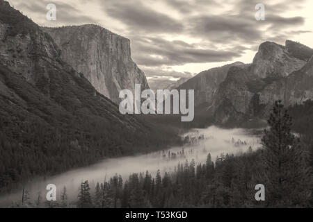The iconic tunnel view of the Yosemite Valley with  low fog in late fall, Yosemite National Park, California, United States. - Stock Photo
