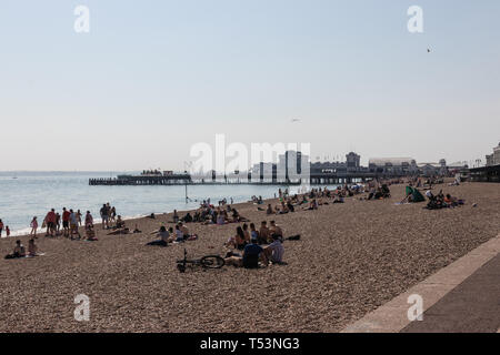 crowds enjoying the easter bank holiday sunshine at southsea beach, Portsmouth - Stock Photo