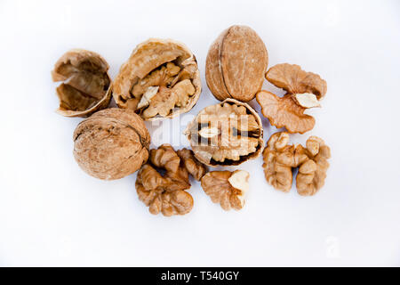 Healthy food and snack. Walnuts kernels on white background. Fruits of walnut. - Stock Photo