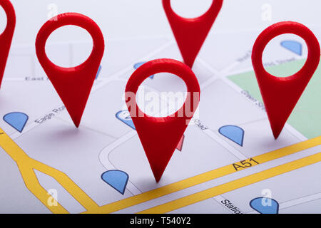 Close-up Of A City Map With Red Location Marker - Stock Photo
