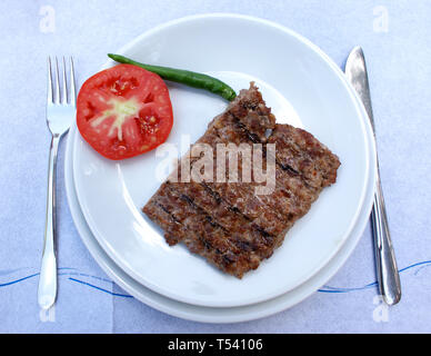 Meat dish at dinner table Eating concept Bread, grilled lamb meat Healthy protein diet concept - Stock Photo