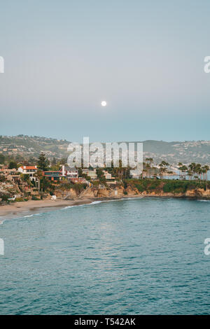 Moonrise over Crescent Bay in Laguna Beach, Orange County, California - Stock Photo