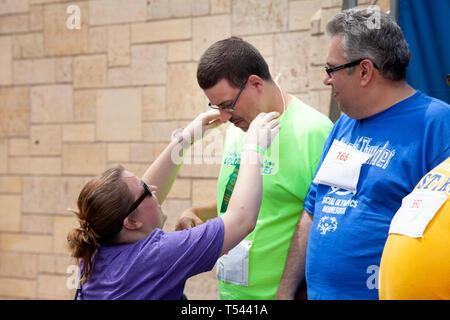 Presenting Special Olympics sports award for developmentally delayed athletes at St. Thomas University. St Paul Minnesota MN USA - Stock Photo