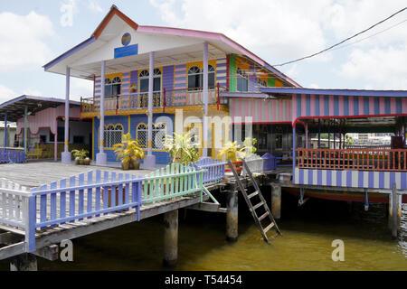 Colorful home in Kampong (Kampung) Ayer water village on Brunei River, Bandar Seri Begawan, Sultanate of Brunei - Stock Photo