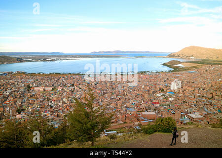 Female Looking at Lake Titicaca from the Condor Hill View Point in Puno, Peru, South America - Stock Photo
