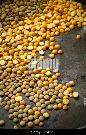 Ingredients dried lentils and yellow split peas in rustic pan - Stock Photo