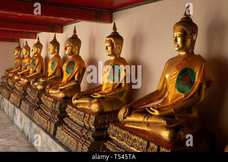 Thailand, Bangkok, Wat Pho, outer Phra Rabiang of Phra Ubosot, line of golden Buddha statues