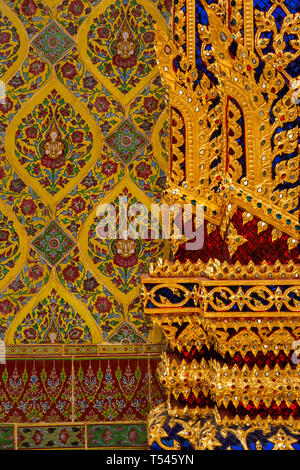 Thailand, Bangkok, Thanon Fuang Nakhon, Wat Ratchabophit Sathitmahasimaram, pillar and wall decoration beside doorway - Stock Photo