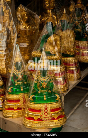 Thailand, Bangkok, Thanon Bamrung Mueang, Buddhist Supplies Shop, green plastic emerald buddhas wrapped in plastic for sale - Stock Photo