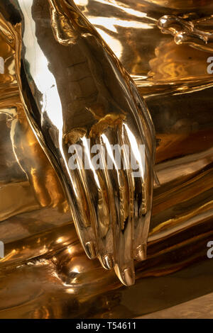 Thailand, Bangkok, Thanon Bamrung Mueang, Soi Mahannop2, Buddhist Supplies Shop, hand of large polished metal Buddha for sale touching ground in Bhumi - Stock Photo