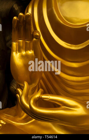 Thailand, Bangkok, Thanon Bamrung Mueang, Soi Mahannop2, Buddhist Supplies Shop, hand of large polished metal Buddha for sale with hands in teaching m - Stock Photo