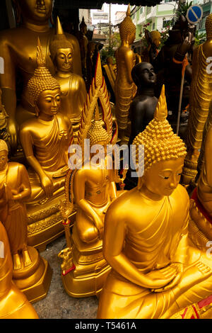 Thailand, Bangkok, Thanon Bamrung Mueang, Soi Mahannop2, golden Buddhas on display outside Buddhist Supplies Shop - Stock Photo
