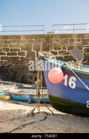 Colourful fishing boats stranded by the low tide in St Ives Harbour, Cornwall, UK - Stock Photo