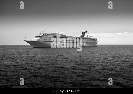 Black And White Image Of The Carnival Cruise Line, Cruise Ship, Carnival Inspiration, At Anchor Off Avalon, Santa Catalina, California, USA. - Stock Photo