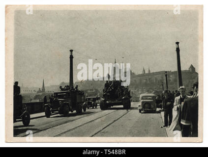 Red Army tanks on the Mánes Bridge (Mánesův most) in Prague, Czechoslovakia, on 9 May 1945. Black and white photograph by an unknown photographer taken in May 1945 and issued in the Czechoslovak vintage postcard in 1945. Courtesy of the Azoor Postcard Collection. - Stock Photo