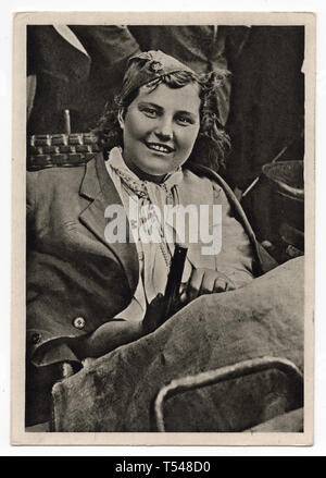 Unidentified Red Army female soldier pictured in the black and white photograph by an unknown photographer taken probably in Prague, Czechoslovakia, in May 1945 and issued in the Czechoslovak vintage postcard in 1945. Courtesy of the Azoor Postcard Collection. - Stock Photo