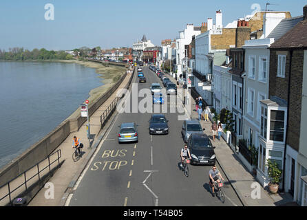view from barnes bridge, london, england, looking east along the terrace, barnes, with the river thames to the left - Stock Photo