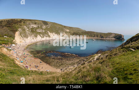 People enjoying the warm Easter Bank Holiday weather at Lulworth Cove in Dorset 2019 - Stock Photo