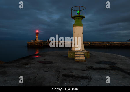 Port and starboard navigation lights at the entrance to the Kalk Bay harbour on the False Bay coast in the Western Cape, South Africa - Stock Photo