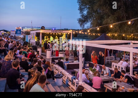 Warsaw, Poland - August 23, 2018: Nightlife in Warsaw. Music concert in outdoor bar at banks of Wisla river in city center - Stock Photo