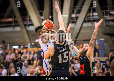London, UK, 20th April 2019. Royals' Wes Washpun (20) finishes off a point. Tensions run high in the London City Royals v Glasgow Rocks BBL Championship game at Crystal Palace Sports Centre. Home team LCR win the tight game 78-70. Credit: Imageplotter/Alamy Live News - Stock Photo