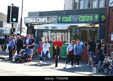 Skegness, UK. 20th Apr, 2019. People seen at one of the very many seafront restaurants selling the traditional British Fish and Chips during Easter. People enjoy the unseasonably warm Easter weather in the UK - especially the children having donkey rides on the sandy beach at Skegness. The traditional seaside attraction started in Victorian times, but is now seen much less in the major resorts, but is still popular on the Lincolnshire beaches of Skegness, Mablethorpe and Ingoldmells. Credit: SOPA Images Limited/Alamy Live News - Stock Photo