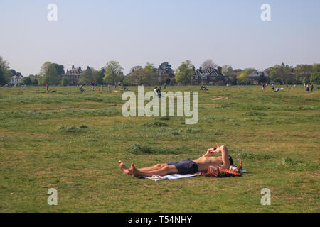 London, UK. 21st Apr, 2019. A man sunbathing  on a sunny and warm Easter Sunday  on Wimbledon Common Credit: amer ghazzal/Alamy Live News - Stock Photo