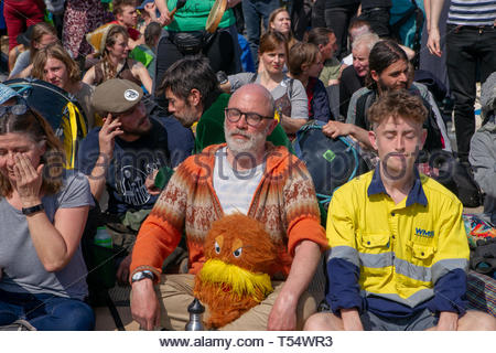 WATERLOO BRIDGE, LONDON, APRIL 19th 2019: Protestors meditate as they await arrest during a peaceful protest about climate change on 19th April 2019. - Stock Photo