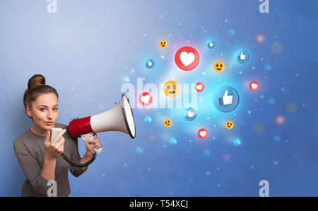 Person holding megaphone and yelling with social media concept  - Stock Photo