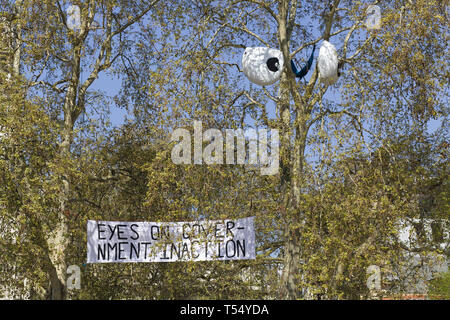 Eyes on government inaction Extinction rebellion protest Parliament square London - Stock Photo