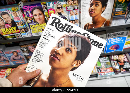 MONTREAL, CANADA - OCTOBER 9, 2018: Rolling Stone magazine in a hand over a stack of magazines with Aretha Franklin on the front cover. Rolling Stone  - Stock Photo