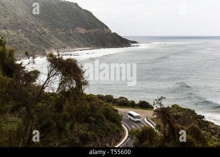 Tourist bus driving along Great Ocean Road, Victoria, Australia. - Stock Photo