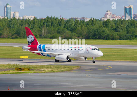 SAINT-PETERSBURG, RUSSIA - JUNE, 2018: Airplane Sukhoi Superjet 100 (RA-89087) of Yamal Airlines in Pulkovo airport on a sunny summer day - Stock Photo