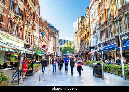 People walking in Irving Street in Leicester Square, London, UK - Stock Photo