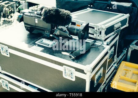 Camera and mic on stage boxes - Stock Photo