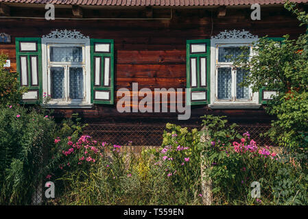 Decorated house in Soce village on so called The Land of Open Shutters trail, famous for traditional architecture in Podlaskie Voivodeship, Poland - Stock Photo