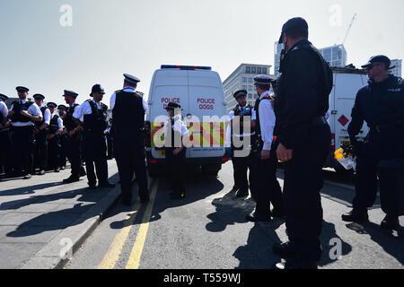 Police prepare to remove Extinction Rebellion demonstrators on Waterloo Bridge in London. - Stock Photo