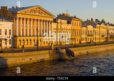 SAINT-PETERSBURG, RUSSIA - MAY 12, 2018: The mansion of Count Rumyantsev and the English Embankment in the light of the setting sun - Stock Photo