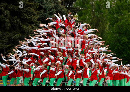 Belarus, the city of Gomel, May 9, 2017. The Victory Day. A living pyramid of people. Colorful structure of human bodies. Flashmob.Mass of people - Stock Photo