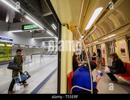 BUDAPEST,HUNGARY - APRIL 12,2019.: People ride Metro in Budapest. Budapest Metro serves 302.4 million rides annually. - Stock Photo